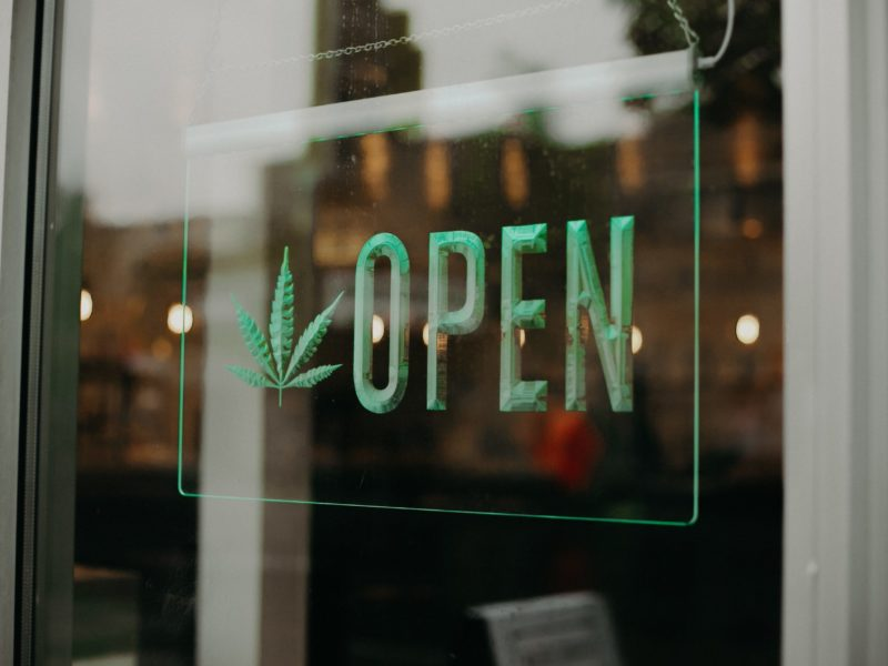 hemp-marijuana-cbd-open-for-business-sign-at-a-dis-QUNAC7T